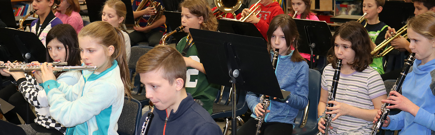 Band students playing instruments.