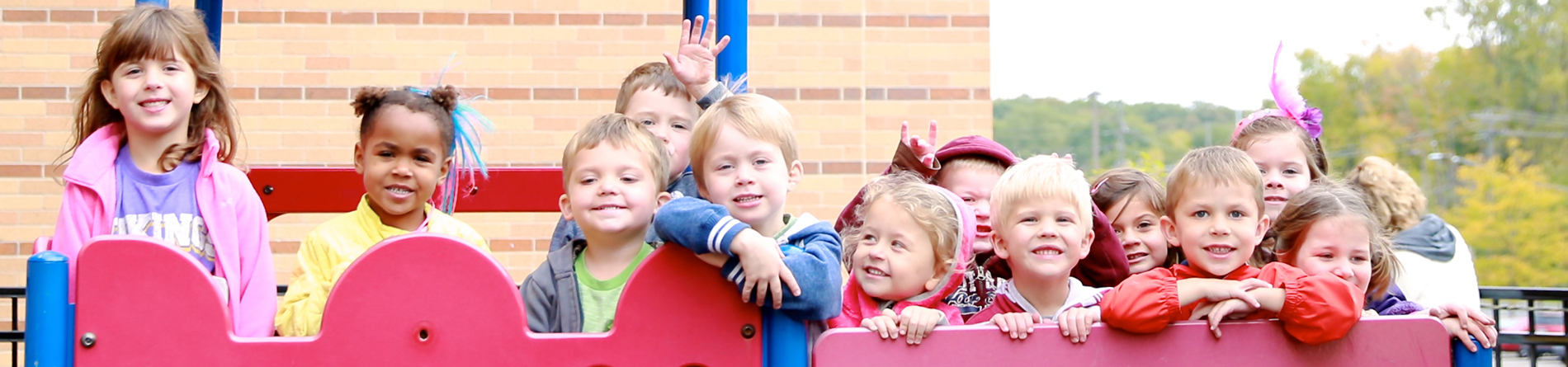 preschool students playing on the playground